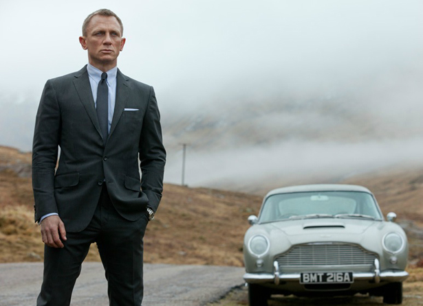 James Bond posing with Vintage Aston Martin for Skyfall