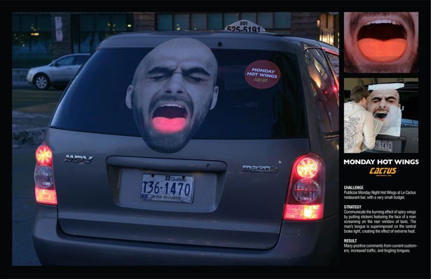 Le cactus restaurant bar communicated the burning effect of spicy wings by putting stickers featuring the face of a men screaming on the rear window of