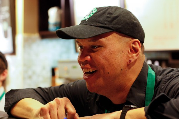 A member of staff working in starbucks.